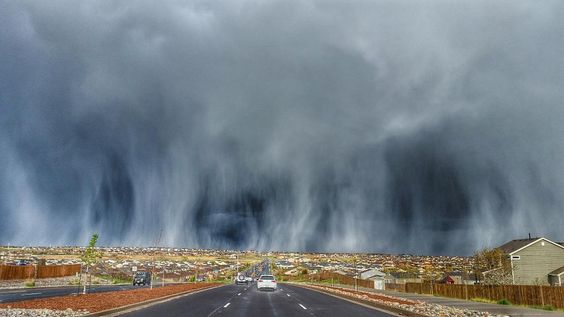 Streaks of hail falling from the clouds created some amazing images in Colorado.