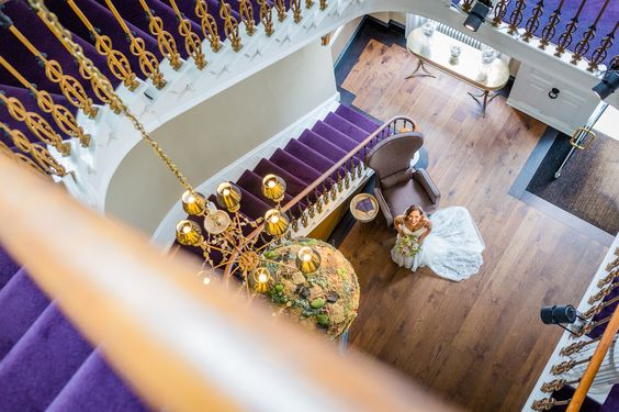Regal purple carpet with gold spindles at the Grade II listed Chichester Harbour Hotel; a hotel wedding venue in Chichester, West Sussex.
