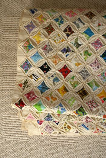 Cathedral window quilt-I made mine into a table runner for my hutch. Really is pretty easy to do, just does take time. But it can be a good take along craft.