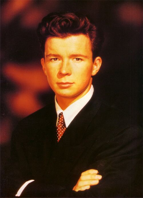 Rick Astley - Never going to give you up. He was Handsome back then and he's even hondsomer now. I've always liked his songs but never had a face to go with the voice. Oh, why did it take me 20 years to find him?