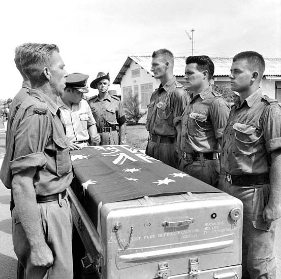 The body of Private Michael (Mick) Alwyn Bourke, 1 RAR, is farewelled at a ceremony at Tan Son Nhut airbase before being flown back to Australia. Just weeks after arriving in Vietnam, 1RAR suffered its first casualties when Private William Carroll's grenade pin caught and released as he leaped off a truck after the battalion's first operation. The subsequent explosion killed Carroll, Privates Mick Bourke and Arie Van Valen, and an American, Private First Class D. Pierson.