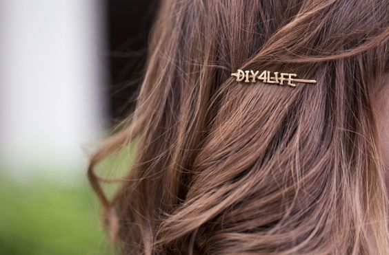 this bobby pin was made from dried alphabet soup pasta! and painted bronze or whatever.