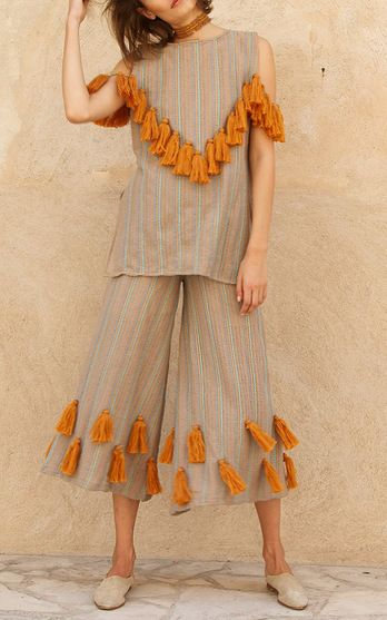 Wanderlust designer, Ayah Tabari, creates colorful embroidered pieces crafted by local artisans she meets on her travels. This season it's about: Inspired by Moroccan culture, Tabari incorporates traditional geometric patterns and rich desert hues into her well-loved silhouettes, embellished with oversized tassels. The piece to buy: The tiered off-the-shoulder blouse.
