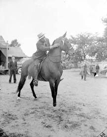 "Boxing great Joe Louis on his five-gaited horse, McDonald's Choice, at what he labeled the ""First All Negro Horse Show"" held on his farm!"