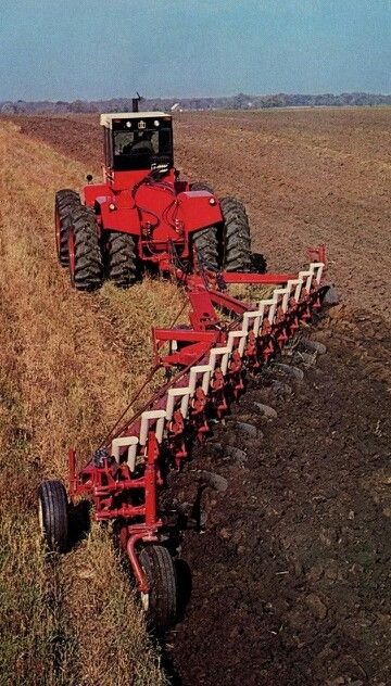 international harvester 800 with a 12bottom plow takes