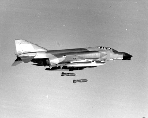 January 30, 1966. Operation Rolling Thunder, the bombing of North Vietnam, resumes. LBJ's diplomatic initiatives during the bombing pause have failed. Photo: Two 750-pound general purpose bombs are released from a camouflaged U.S. Air Force F-4C Phantom fighter bomber. Photograph VA061405, No Date, George H. Kelling Collection, The Vietnam Center and Archive, Texas Tech University.