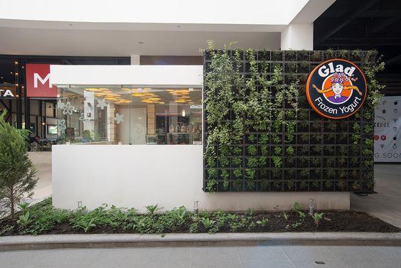 Diseno de kiosko para heladeria glad arquitectura muro for Muros verdes arquitectura