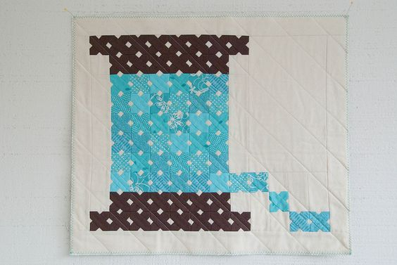 "Do you SEE those little tiny ""x"" squares that look like cross stitching? Be still my crafty little heart! :)"