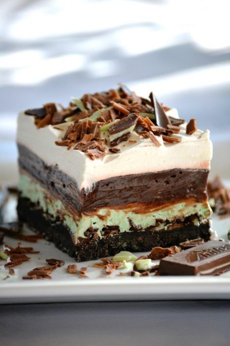 These Chocolate Mint Dream Bars are the perfect No-Bake dessert. The cookie crust, chopped Andes Mints, peppermint, pudding and whipped topping will have everyone swooning!