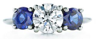 Tiffany three stone with sapphire side stones