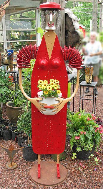 yard art made with an ironing board.........  Jim Shores Art
