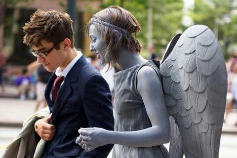 Cosplaying's not really my thing, but I love these two dressed up as The Doctor and a Weeping Angel!
