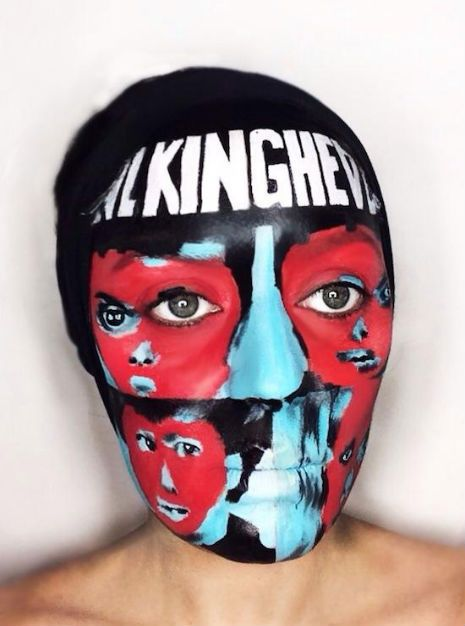 talking heads remain in light face paint...
