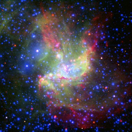 A composite image blends x-ray, infrared, and visible light data from several telescopes to portray a colorful cloud of newly forming stars in an irregular dwarf galaxy 210,000 light-years away.