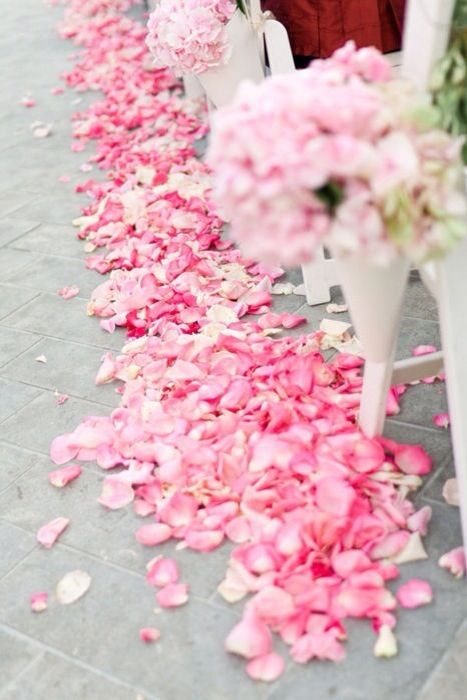 Rose petals are an excellent addition to bouquets and arrangements of wedding flowers. Rose petals are often used to create an aisle; however, lining the aisle is also VERY attractive!: