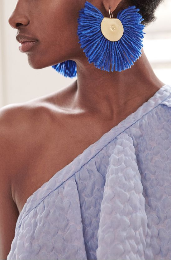 When giving the cold shoulder in RosieAssoulin's breezy top, take the opportunity to showcase The One statement earring of the season by Katerina Makriyianni.