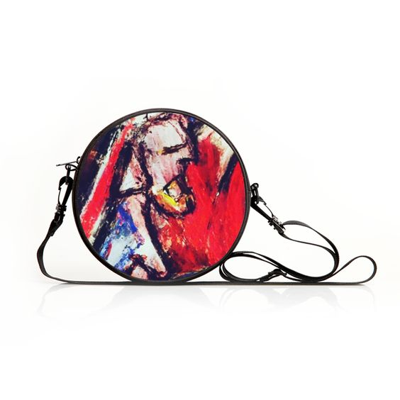A funky bag with a funky man, art decorated and ar
