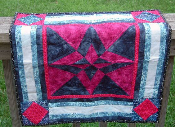 Tweeting in the Crimson Sunrise. Auction quilt I donated to the guild. Day and Night pattern by Quilter's Cache