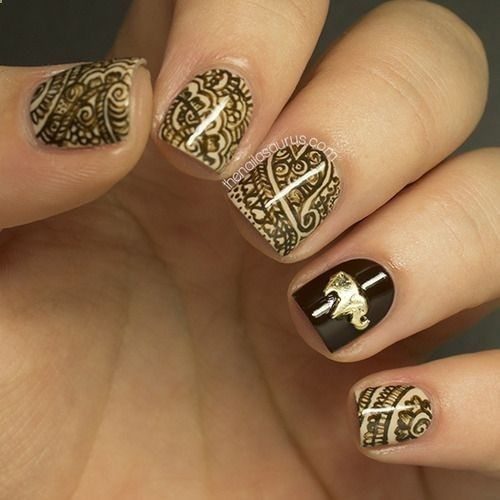 Indian/elephant gold and black nail design