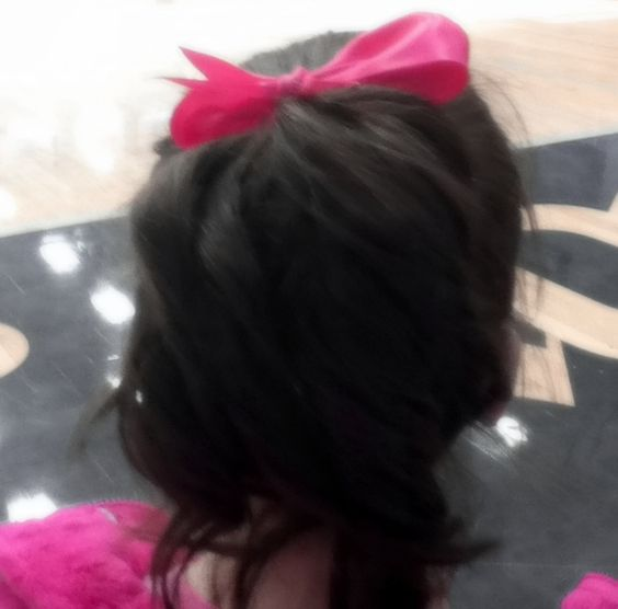 Curly hair with a bow.