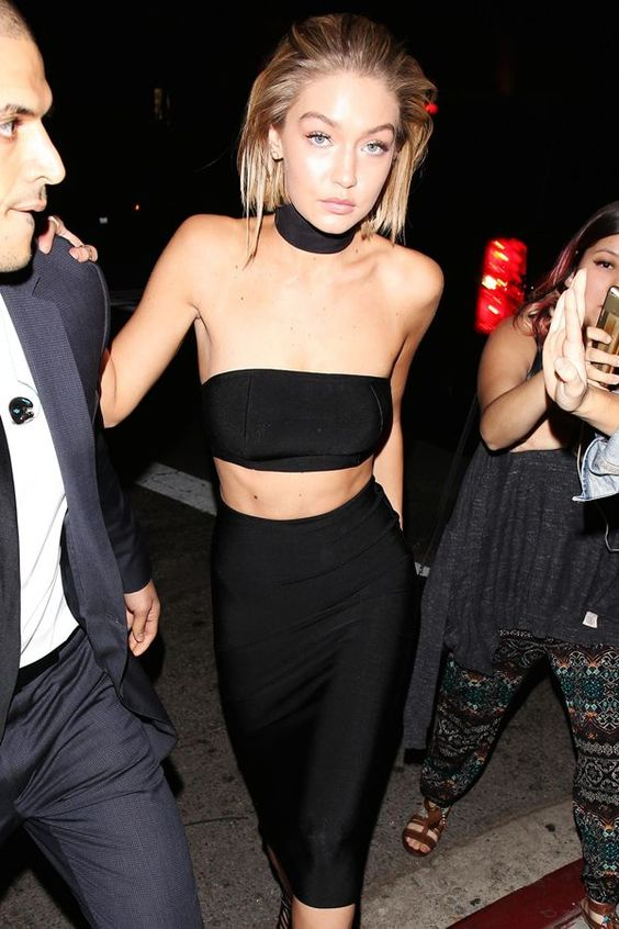 The One Outfit That All The Celebrities Are Wearing #refinery29  http://www.refinery29.com/celebrity-neck-band-top-trend#slide-3  Clearly keen on the trend, Hadid brought back the band-meets-bandeau play for the AMAs' after-party. Like her BFF Kendall, she opted for a strapless crop top and high-waisted bottom — in this case, a pencil skirt — from House of CB, paired with a matching neckpiece. ...: