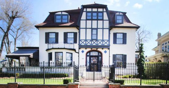 Even inside Detroit's Indian Village this tall, timbered structure stands out. With its square shape, double-hipped roof and red tile shingles, the architecture is closest to German Baroque plus strong input from the Arts and Crafts Movement.