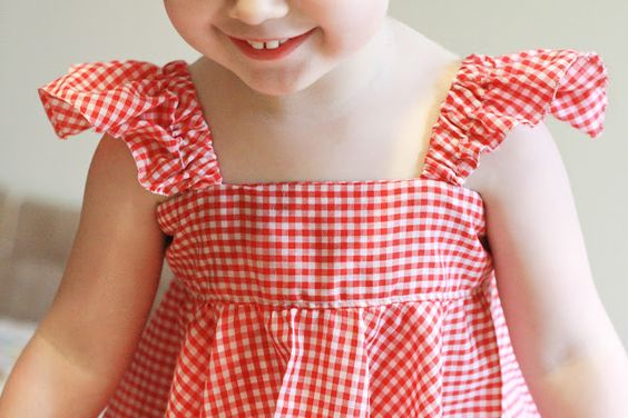 Circle skirt dress. Sleeves are semi-circles with elastic.