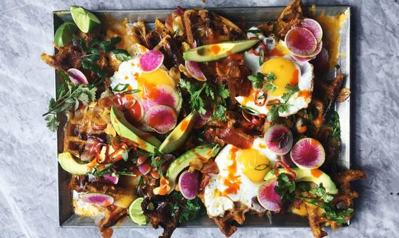Tex-Mex Breakfast Waffle Nachos - Bon Appetit - It's breakfast! It's brunch! It's a snack! It's a glorious mess. And in case you're wondering, the waffles are pretty amazing just on their own.