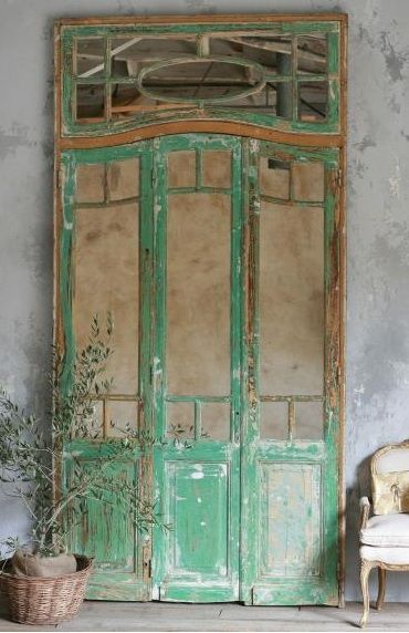 Stunning large-scale panelled mirror doors with arched tops and transom, in distressed and chipping green paint finish: