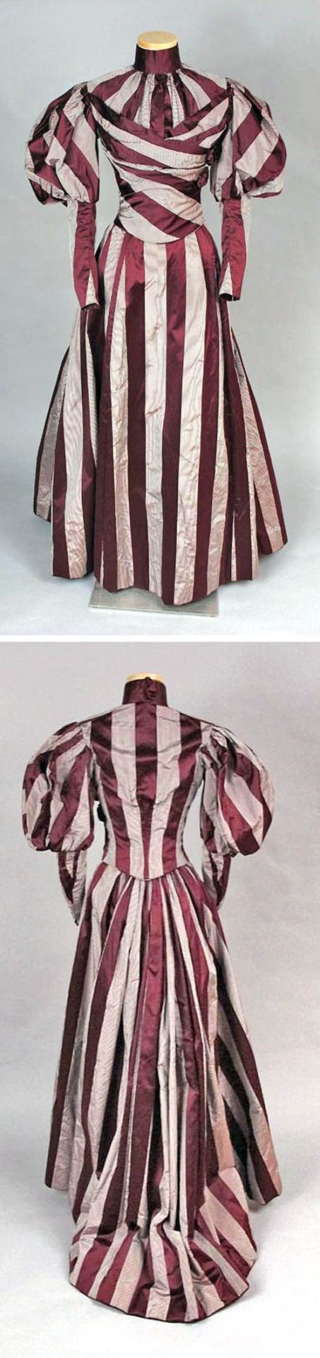 Two-piece day dress, ca. 1897. Maroon silk satin with plain-woven stripes of thin white & black stripes lined with tan cotton. Closely fitted, with boned seams & darts. Skirt has very narrow pleats every few inches for ease of movement; pocket in rear right seam. emuseum of the Connecticut Historical SocietySource