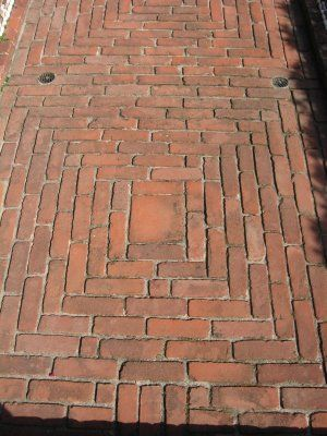 These standard size and shape bricks form a surround for the large square. They're all the same color, but definitely form a great look and style to work for any patio or deck.
