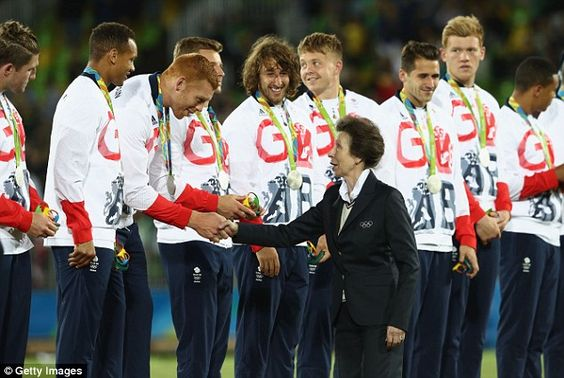 The British rugby sevens team remained standing as Princess Anne awarded them silver