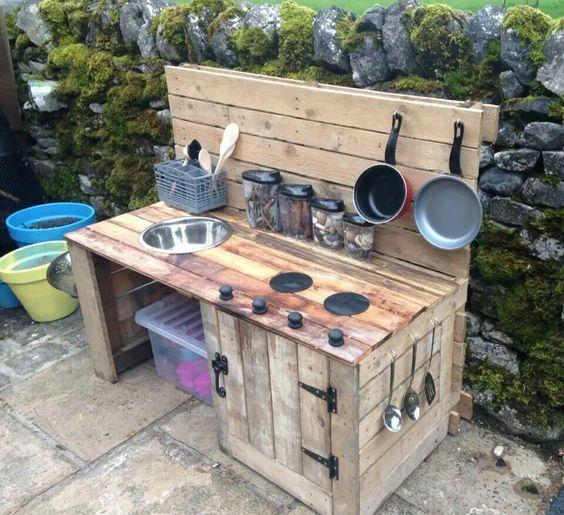 DIY outside Kitchen using wood or real cooker. Also essential and fairly easy/cheap I think! Hours of fun mixing mud leaves and all sorts!