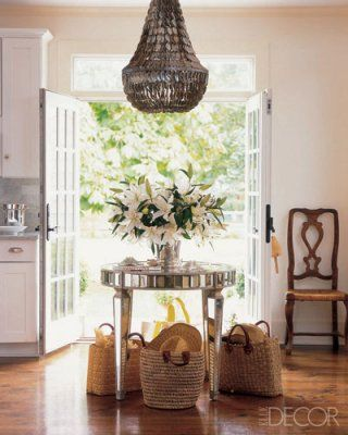 Love the Oly shell chandelier and the baskets under the table