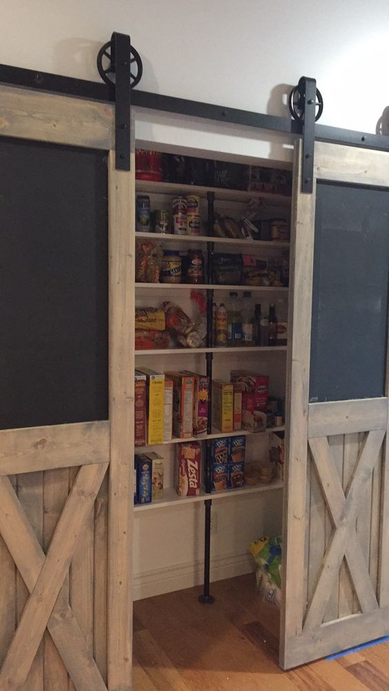 DIY Barndoors with magnetic chalkboard inserts and galvanized pipe pantry shelves!