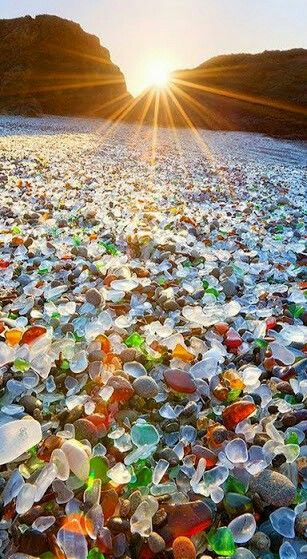 Beautiful sinrise and glass pebbles ......... .:
