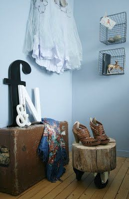 Love the tree stool, the graphic letters and the wire baskets on the wall!