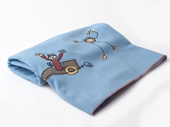 Embroidered Fleece Throw by Helena Springfield.