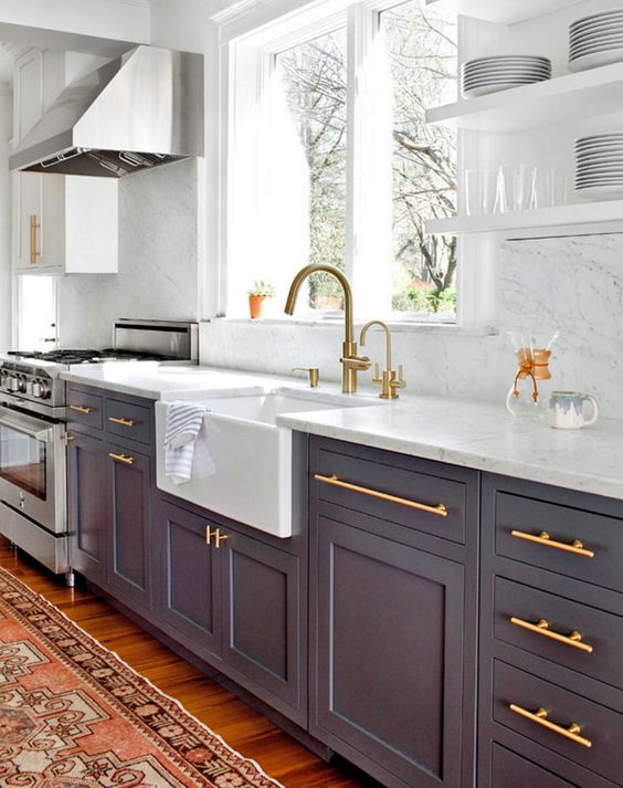Dark grey kitchen cabinets in modern farmhouse style kitchen with #brasshardware, apron front #farm sink, and #openshelves