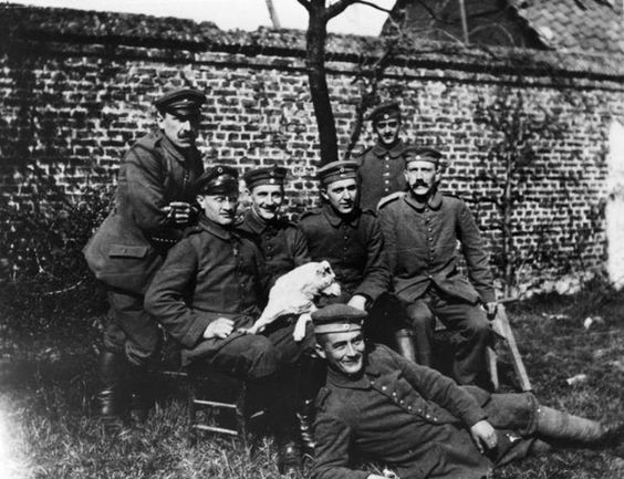 Adolf Hitler (far right seated) with his army comrades of the Bavarian Reserve Infantry Regiment 16 (c. 191418)