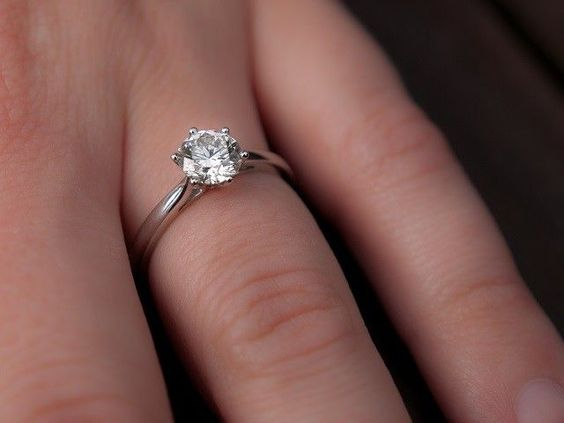 Gleaming Solitaire Engagement Rings