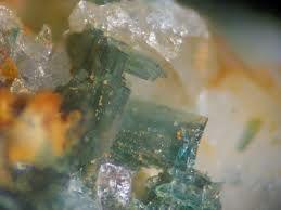 Souzalite.Colour:Blue-green, dark gray-green. Hardness (Mohs):5½ - 6.Type Locality:Córrego Frio mine, Linópolis, Divino das Laranjeiras, Doce valley, Minas Gerais, Brazil. Year of Discovery:1947.