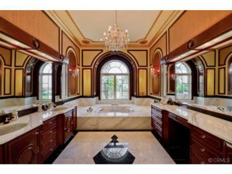 This opulent mansion is located 19004 Ashurst Lane in the private section of Gated Mulholland Park in Tarzana, CA. It was built in 1996 and boasts 11,000 square feet of living space with 5 bedrooms an