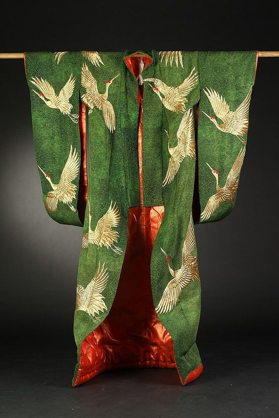 JAPANESE EMBROIDERED GREEN SILK THEATER KIMONO. Worked with gold thread to depict crane decoration. - 74 in. high.