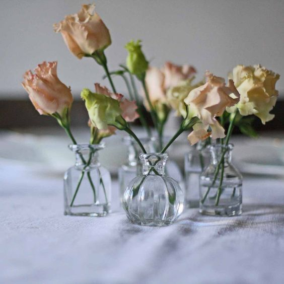 Grouping of 6 Tiny Glass Bottle Vases For Weddings available from @theweddingomd