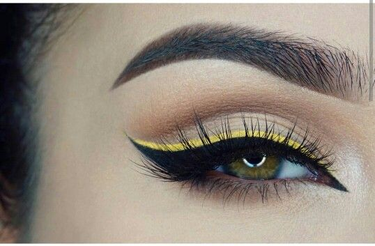 eye makeup. yellow and black eyeliner
