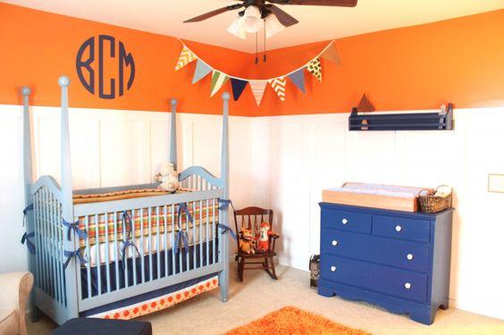 This orange border brightens up a cute baby boy nursery. {The monogram adds a preppiness we just love!} #nursery #babyboy