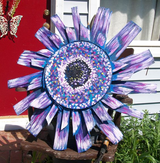 """Purple Gerber Daisy  made entirely from old bushel crab baskets from the eastern shore.  31"""" across  painted with enamels, they can be displayed outside.  by Dawn Tarr DAWN TARR ART"""