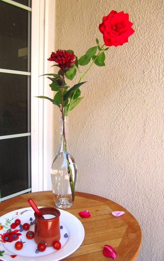 rose in wine bottle