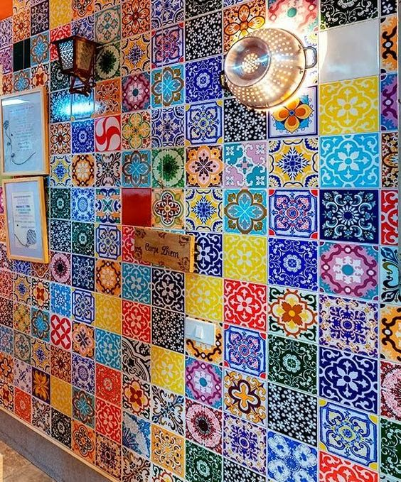 Funky eclectic tiled  kitchen wall..